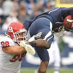 Oct 31, 2009; East Hartford, CT, USA; Rutgers defensive end Evan Lampert (98) makes a tackle on a punt return during second half Big East NCAA football action in Rutgers' 28-24 victory over Connecticut at Rentschler Field.