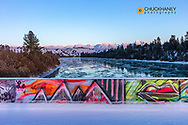 Graffitti on the Sloan Bridge above The Flathead River after a fresh snowfall in the Mission Valley, Montana, USA