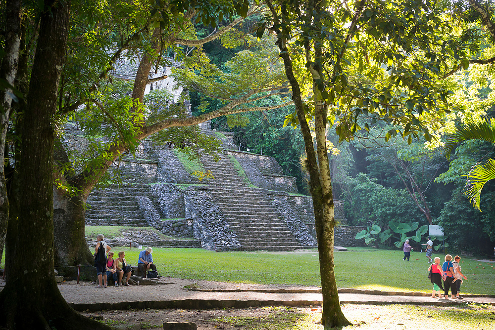 Visitors walk and rest outside the Templo de la Calavera (Temple of the Skull), one of several Mayan structures in Palenque, Mexico. The Mayan city flourished in the 7th century.