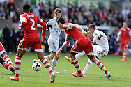 Swansea city's Pablo Hernandez ® shoots wide of goal.  Barclays Premier league match, Swansea city v Southampton at the Liberty stadium in Swansea, South Wales on Saturday 3rd May 2014.<br /> pic by Andrew Orchard, Andrew Orchard sports photography.