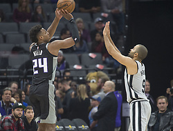 December 23, 2017 - Sacramento, CA, USA - The Sacramento Kings' Buddy Hield (24) hits a 3-point basket against the San Antonio Spurs' Tony Parker (9) on Saturday, Dec. 23, 2017, at Golden 1 Center in Sacramento, Calif. (Credit Image: © Hector Amezcua/TNS via ZUMA Wire)