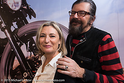 LowRide Magazine staff Marie-Line Thioulouze and editor Giuseppe Roncen during EICMA, the largest international motorcycle exhibition in the world. Milan, Italy. November 21, 2015.  Photography ©2015 Michael Lichter.