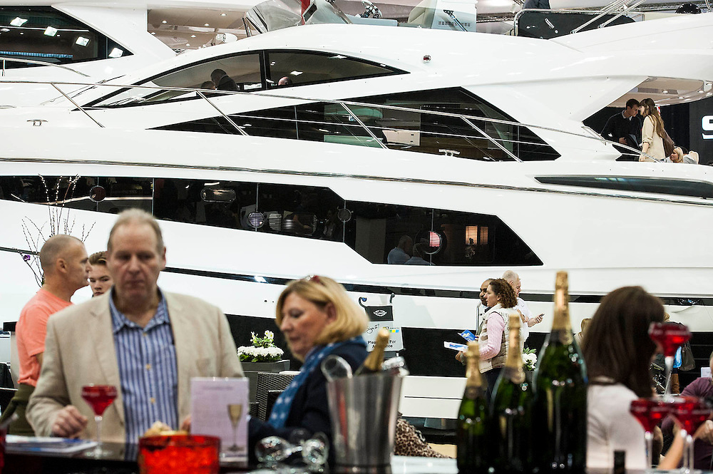 The champagne bar on the Sunseeker stand. The London Boat Show opens at the Excel Centre, Docklands, London, UK 04 January 2014. Guy Bell, 07771 786236, guy@gbphotos.com