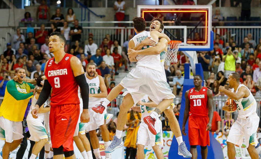 Canada's Dillon Brooks (9) walks off the court as Brazil celebrates winning the gold medal in men's basketball at the Pan Am Games in Toronto, Saturday July 25, 2015. THE CANADIAN PRESS/Mark Blinch