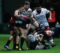 Ospreys' Jeff Hassler under pressure from Dragons' Sarel Pretorius<br /> <br /> Photographer Simon King/Replay Images<br /> <br /> Guinness Pro14 Round 12 - Dragons v Cardiff Blues - Sunday 31st December 2017 - Rodney Parade - Newport<br /> <br /> World Copyright © 2017 Replay Images. All rights reserved. info@replayimages.co.uk - http://replayimages.co.uk