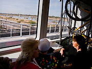 11 JANUARY 2009 -- PHOENIX, AZ: Riders on the new METRO light rail between Phoenix and Tempe. The METRO started running on Dec 27, 2008, three weeks after the grand opening weekend trains are still crowded.  PHOTO BY JACK KURTZ