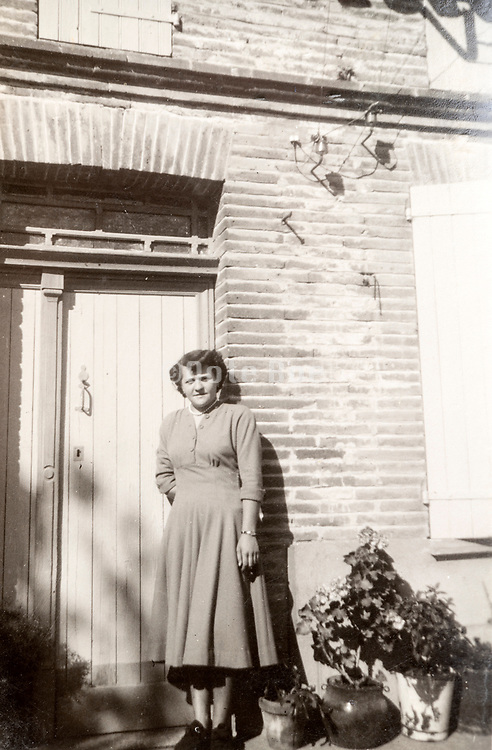 woman posing by door in front of the house France 1949