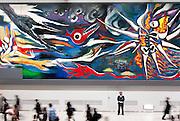 "A security guard stands in front of the 30-metre-long painting called ""Myrth of Tomorrow"" by the Japanese artist Taro Okamato in Shibuya Station, Tokyo, Japan. Wednesday, November 19th 2008"