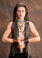 """Wild Prayer. Beautiful wild spirit woman in shamnic yoga prayer.<br /> :::<br /> """"One of the great disservices a culture of domination has done to all of us is to confuse the erotic with domination and violence. The God is wild, but his is the wildness of connection, not of domination. Wildness is not the same as violence. Gentleness and tenderness do not translate into wimpiness. When men — or women, for that matter — begin to unleash what is untamed in us, we need to remember that the first images and impulses we encounter will often be the stereotyped paths of power we have learned in a culture of domination. To become truly wild, we must not be sidetracked by the dramas of power-over, the seduction of addictions, or the thrill of control. We must go deeper.""""<br /> -Starhawk"""
