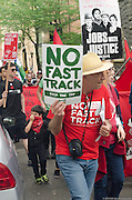 Demonstrator in 2015 May Day rally and march in Portland, Oregon holds a sign saying No Fast Track