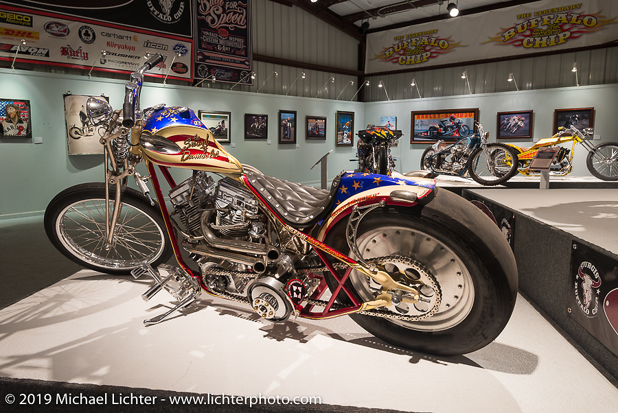 """Paul Cox's Panhead in the """"Built for Speed"""" exhibition curated by Michael Lichter and Paul D'Orleans in the Russ Brown Events Center as part of the annual """"Motorcycles as Art"""" series at the Sturgis Buffalo Chip during the Black Hills Motorcycle Rally. SD, USA. August 5, 2014.  Photography ©2014 Michael Lichter."""