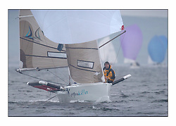 Racing at the Bell Lawrie Yachting Series in Tarbert Loch Fyne. Saturday racing started overcast but lifted throughout the day...David Lowe onboard Karma Killer GBR7690T.