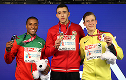 Azerbaijan's Nazim Babayev (centre), Portugal's Nelson Evora (left) and Germany's Max Heb with their medals at the Men's Triple Jump Final during day three of the European Indoor Athletics Championships at the Emirates Arena, Glasgow.