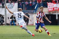 Atletico de Madrid´s Ansaldi (R) and Deportivo de la Coruña´s Laure during 2014-15 La Liga match between Atletico de Madrid and Deportivo de la Coruña at Vicente Calderon stadium in Madrid, Spain. November 30, 2014. (ALTERPHOTOS/Victor Blanco)