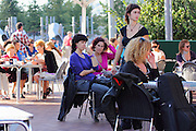 Women sit in a café opposite the Guggenheim museum in Bilbao, listening to jazz on a sunny October Sunday afternoon. A few sport the short fringe that is very popular among women (and some men) in the city.