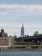 Empire State building with Manhattan bridge in foreground