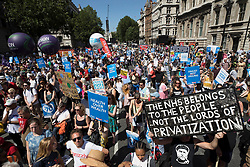 © Licensed to London News Pictures. 30/06/2018. London, UK.  Protestors gather in Whitehall in support of the National Health Service on the 70th anniversary of it's founding. Thousands are taking part and will hear speeches by Jeremy Corbyn and others in Whitehall. Photo credit: Peter Macdiarmid/LNP