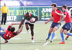 March 5, 2017 - Las Vegas, Nevada, United States of America - Kenyan Daniel Sukota runs by Russian defenders during the 2017 USA Sevens International Rugby Tournament game between Kenya and Russia on March 4, 2017  at Sam Boyd  Stadium  in Las Vegas, Nevada (Credit Image: © Marcel Thomas via ZUMA Wire)