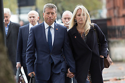 © Licensed to London News Pictures. 05/11/2015. London, UK. British DJ, Neil Fox (known as Dr Fox) with his wife, Vicky arrives at Westminster Magistrates court in London. Neil Fox is accused of a number of historical child sex offences and faces 13 counts of indecent assault and two of sexual touching without consent against victims aged between 13 and 16. Photo credit : Vickie Flores/LNP