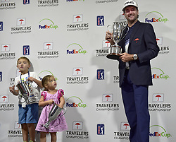 June 24, 2018 - Cromwell, CT, USA - Bubba Watson holds the 2018 Travelers Championship trophy while his children, Caleb, 6, and Dakota, 3, reach into their own trophies given to them by the Travelers tournament staff. Watson came from six strokes down to win with a 7-under par 63 and finished at -17 at TPC River Highlands in Cromwell, Conn., on Sunday, June 24, 2018. (Credit Image: © John Woike/TNS via ZUMA Wire)