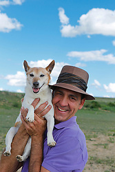 Jack Russell dog and man smiling together outdoors