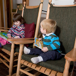 Young children enjoy some books in the Appalachian Mountain Club's Cardigan Lodge.
