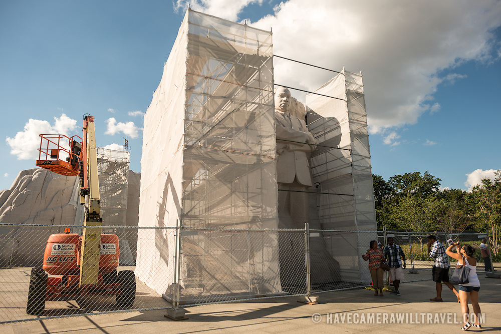 Scaffolding surrounds the statue of Martin Luther King Jr as the artist removes a controversial inscription on the side of the monument at the Tidal Basin in Washington DC.
