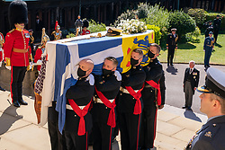 The Prince of Wales looks on as The Duke of Edinburgh's coffin, covered with his Personal Standard, is carried into St George's Chapel, Windsor Castle, Berkshire, ahead of the funeral of the Duke of Edinburgh. Picture date: Saturday April 17, 2021.