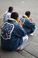 "Happi Coats at Kamakura Matsuri - Japanese festivals are traditional festive occasions. Some festivals have their roots in Chinese festivals but have undergone dramatic changes as they mixed with local customs.  Matsuri is the Japanese word for a festival or holiday. In Japan, festivals are usually sponsored by a local shrine or temple, though they can be secular.<br /> There is no specific matsuri days for all of Japan; dates vary from area to area, and even within a specific area, but festival days do tend to cluster around traditional holidays such as Setsubun or Obon. Almost every locale has at least one matsuri in late summer or autumn, usually related to the harvests. Matsuri almost always feature processions which include elaborate floats and ""mikoshi"" or portable shrines which are paraded around the neighborhood, and sometimes even into the ocean along the coast."