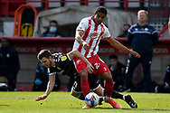 Crawley Town midfielder Tyler Frost (11) battles for possession  with Stevenage defender Luther James-Wildin (2) during the EFL Sky Bet League 2 match between Stevenage and Crawley Town at the Lamex Stadium, Stevenage, England on 1 May 2021.