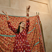 """Ismet—who did not give her last name—lives in Harsukh. The word """"Harsukh"""" means """"divine peace,"""" and the community hosts all types of artists, from poets and musicians to yoga teachers and dancers. Here, she performs kathak, a traditional dance that her mother taught her."""