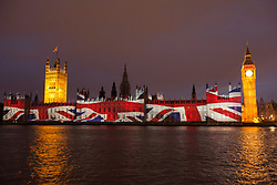 © licensed to London News Pictures. London, UK 27/07/2012. Union flag being projected on the Houses of the Parliaments during the Olympics opening ceremony on 27/07/12. Photo credit: Tolga Akmen/LNP