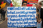 London, UK. Saturday 18th May 2013. Protestors march in a demonstration against NHS reform and proposed funding cuts for services within the National Health Service.
