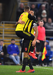 Watford's Gerard Deulofeu (left) celebrates scoring his side's third goal of the game with team-mate Troy Deeney during the Premier League match at the Cardiff City Stadium.