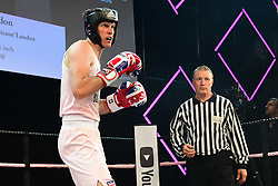 Hugo Loudon (pink) and Cobi Levy (black) boxing at the Boodles Boxing Ball, in association with Argentex and YouTube in Support of Hope and Homes for Children at Old Billingsgate London, United Kingdom - 7 Jun 2019 Photo Dominic O'Neil