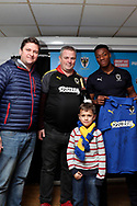 AFC Wimbledon defender Paul Kalambayi (30) and sponsors  during the EFL Sky Bet League 1 match between AFC Wimbledon and Barnsley at the Cherry Red Records Stadium, Kingston, England on 19 January 2019.