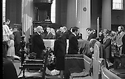 State Funeral Of Mrs Thomas Clarke..1972..08.10.1972..10.08.1972..8th October 1972..Today the state funeral of Mrs Kathleen Clarke took place at the Pro Cathedral,Dublin. Mrs Clarke was the wife of the late Thomas Clarke who was executed in Kilmainham Jail in 1916. Thomas Clarke was a signatory of the Irish Proclamation of 1916...Pictured passing the Tricolour draped coffin were Mr Des O'Malley TD,Minister for Justice and Mr Joe Brennan TD Minister for Labour. An Taoiseach, Mr Jack Lynch is seen kneeling to their right.