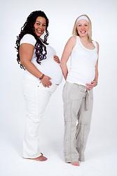 Portrait of two pregnant women,