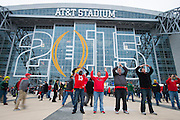 Fans wait to enter AT&T Stadium for the College Football Playoff National Championship Game on January 12, 2015 in Arlington, Texas.  (Cooper Neill for The New York Times)