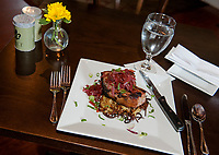House-raised smoked pork chop with potato latkes and parsnip apple puree with red onion jam at The Local Eatery Tuesday evening.  (Karen Bobotas/for the Laconia Daily Sun)