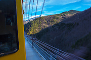 The Train Jaune, Yellow Train, Canari, or Ligne de Cerdagne, crossing the Pont Gisclard suspension bridge on the 63km long railway from Villefranche-de-Conflent to Latour-de-Carol, rising from 427m to 1,593m at Bolquère-Eyne, the highest railway station in France. In early 2015 the future of the line was uncertain, with SNCF and the French government considering either to close the line, or to privatise it for tourism use.