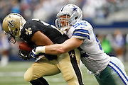 Dallas Cowboys inside linebacker Dan Connor (52) tackles New Orleans Saints running back Pierre Thomas (23) at Cowboys Stadium in Arlington, Texas, on December 23, 2012.  (Stan Olszewski/The Dallas Morning News)