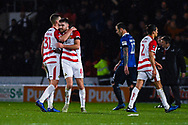 Ben Whiteman of Doncaster Rovers (8) is hugged by Paul Downing of Doncaster Rovers (31) after his two goals win the tie for Doncaster during the The FA Cup fourth round match between Doncaster Rovers and Oldham Athletic at the Keepmoat Stadium, Doncaster, England on 26 January 2019.