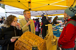 Pictured: Willie Rennie, Hannah Betsworth chatted with and sampled the wares of David Hopkins, New Caledonian Woodlands<br /> <br /> Liberal Democrat leader Willie Rennie and  Hannah Bettsworth, Liberal Democrat candidate for Edinburgh Central and the Lothian regional list, headed to Stockbridge today to meet Easter shoppers and stallholders at the Sunday farmers market. <br /> <br /> Ger Harley | EEm 27 March 2016