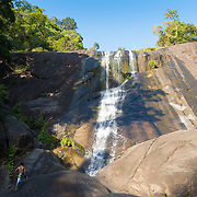 Climbing the huge rocks of Langkawi Telaga Tujuh waterfalls