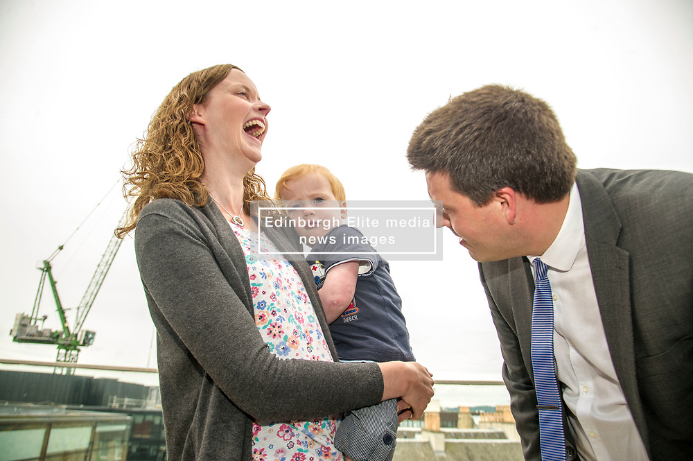 Pictured: Jamie Hepburn tries to make friends with three year old Jack Maclean and his mother Claire<br /> <br /> Employment Minister Jamie Hepburn visited Maclay Murray and Spens today as the latest unemployment figures were released. Mr Hepburn met employees who have benefited from family-friendly working policies. He was welcomed to Quatermile One by Amanda Jones, Partner and Head of Dispute, Claire Maclean (Senior Solicitor) and her three year old son Jack, and Alan Delaeny, Director<br /> of Employment, Pensions and Immigration.<br /> Ger Harley | EEm 14 June  2017