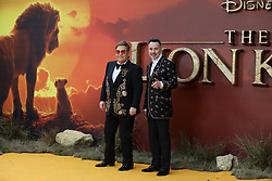 Elton John and David Furnish attend The Lion King premiere in London.<br />