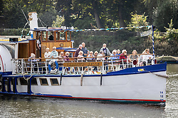 Licensed to London News Pictures. 15/09/2021. London, UK. Members of the public enjoy a boat trip on the Thames at Richmond, south west London as weather forcasters predict a warmer few days ahead with highs of 24c for London and the South East. Photo credit: Alex Lentati/LNP