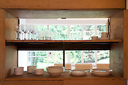 View into the dining room through the pantry cupboards at Warren House, Wayne McGregor's Dartington Estate home in Devon<br /> Vanessa Berberian for The Wall Street Journal