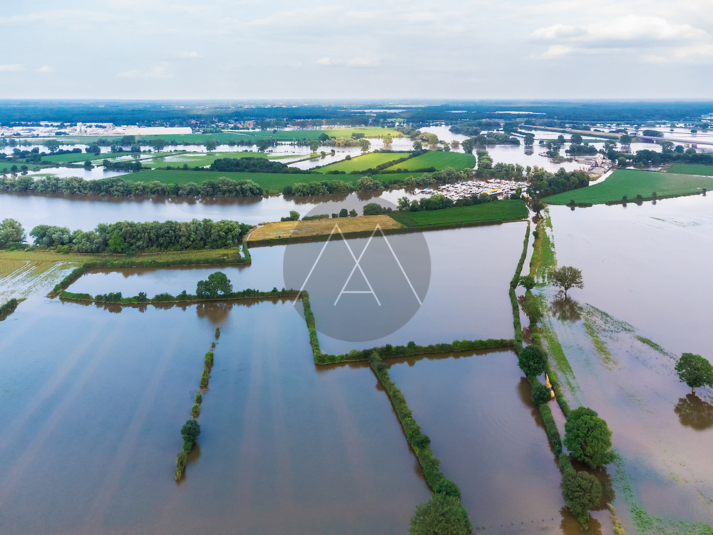 Aerial view of flooded farmland during a high water period in summer on floodplains of river Maas with side branch Oude Maas and marina, Beugen, Noord-Brabant, The Netherlands.